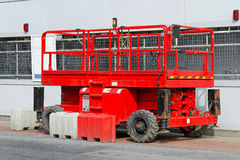 Scissor platform lift. Used on construction site Stock Images