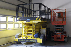 Scissor platform lift vehicles Stock Photo