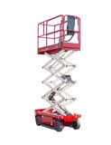 Scissor self propelled lift on a light background. Mobile aerial work platform - red and white scissor hydraulic self propelled lift on a light background Stock Image
