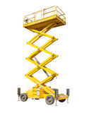 Scissor self propelled lift on a light background. Mobile aerial work platform - yellow scissor hydraulic self propelled lift on a light background Stock Images
