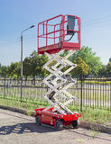 Scissor self propelled lift. Mobile aerial work platform - red and white scissor hydraulic self propelled lift Royalty Free Stock Photography