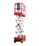 Scissor self propelled lift. Mobile aerial work platform - red and white scissor hydraulic self propelled lift on light background Stock Photo