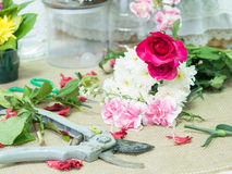 Scissor on table of flowers arrangement. Scissor on table of flowers arrangement decoration Stock Image