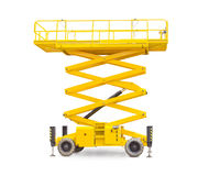 Scissor wheeled lift on a light background. Yellow scissor wheeled lift on a light background Stock Photos