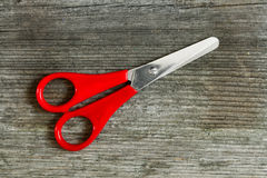 Scissor on wood Stock Image