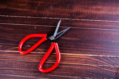 Scissor on wooden board background Royalty Free Stock Photography