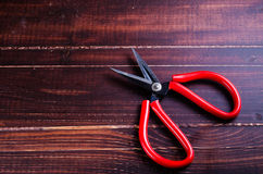 Scissor on wooden board background Royalty Free Stock Photos
