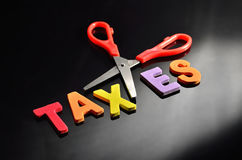 Scissors and the alphabet TAXES Royalty Free Stock Image