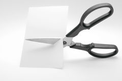 Scissors As Concept. Scissors cutting through white cardboard Royalty Free Stock Photography