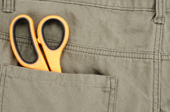Scissors in back pocket pant Stock Photography