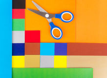 Scissors on background of colored paper Stock Image