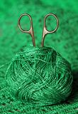 Scissors in a ball of green yarn Stock Photography