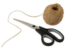 Scissors and ball of woolen thread Stock Photos