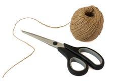 Scissors and ball of woolen thread. Scissors and a ball of woolen thread isolated on white Stock Photos