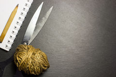 Scissors and a ball of yarn Royalty Free Stock Photography