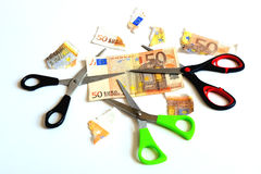 Scissors and banknote euro. On a white background Stock Photo