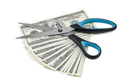 Scissors on batch of dollars isolated on white Royalty Free Stock Photo