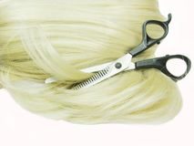 Scissors in blond hair Royalty Free Stock Photo