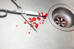 Scissors and blood in the sink Stock Images