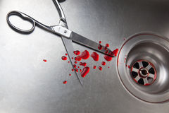 Scissors and blood in the sink Stock Photo
