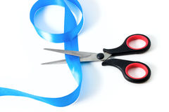 Scissors with blue ribbon Royalty Free Stock Photos