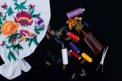 Scissors, bobbins with thread. Set of colored threads in the bobbin with scissors. Sewing kit. Sewing accessories: scissors, tape, Stock Photo