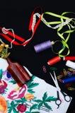 Scissors, bobbins with thread. Set of colored threads in the bobbin with scissors. Sewing kit. Sewing accessories: scissors, tape, Stock Photos