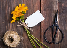 Scissors and bouquet of yellow flowers Royalty Free Stock Photo