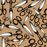 Scissors on brown background seamless pattern Stock Photo