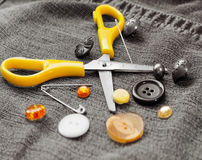 Scissors, buttons and needle Stock Images