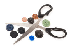 Scissors and buttons. On white background Stock Images