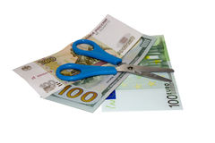 Scissors and cash. Bankruptcy symbol Royalty Free Stock Images