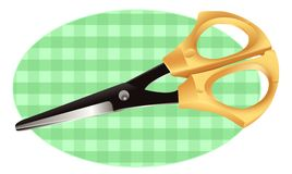 Scissors on a checkered cloth Stock Photography