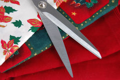Scissors and Christmas Fabrics Stock Image