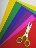 Scissors on color paper background Royalty Free Stock Images