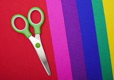Scissors on color paper background Stock Photos