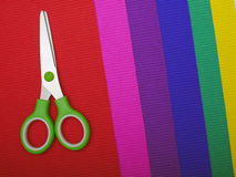 Scissors on color paper background Royalty Free Stock Photos