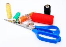 Scissors and color threads Stock Image