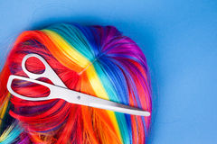 Scissors with color wig Royalty Free Stock Images