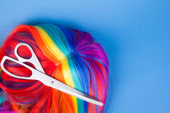 Scissors with color wig Stock Photo