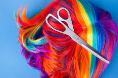Scissors with color wig Stock Images