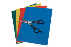 Scissors on colored paper Stock Images