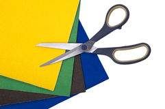 Scissors on colored paper on white Stock Photo