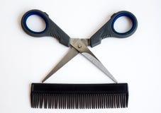 Scissors and comb. Scissors and comb on white Stock Photos