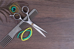 Scissors and comb on  wooden background. Hairdresser salon concept. Haircut  accessories Stock Photos