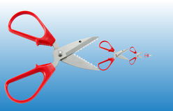 Scissors concept as big fish eat small fish. On bule background as water Royalty Free Stock Image