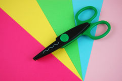 Scissors and Construction Paper. Craft scissors and colorful construction papers Stock Photos