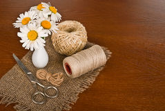 Scissors, cord and flower in vase Stock Photo