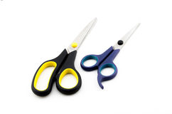 Scissors. Couple Scissors (black and blue) isolated on white background Stock Photos