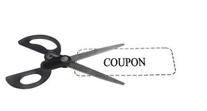 Scissors with coupon. Pair of scissors on top of a white generic coupon Stock Images